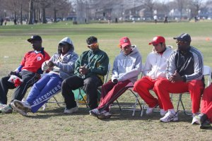 Americas Cricket Academy look on at presentation ceremony