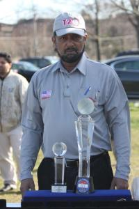 Mohiuddun Khawaja Tournament Committee with the winners trophy and replica