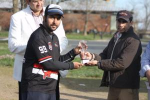 Challengers Captain collects the winners replica trophy