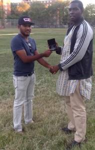 velloCricket/EACA Trivia Winner, USA U-19 19 Batsman Trevis Ross receives his Token from Dyon Ravello