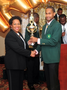 MVP Alex Amsterdam (right) accepts one of his many accolades from fellow Atlantis player Joan Alexander-Serrano