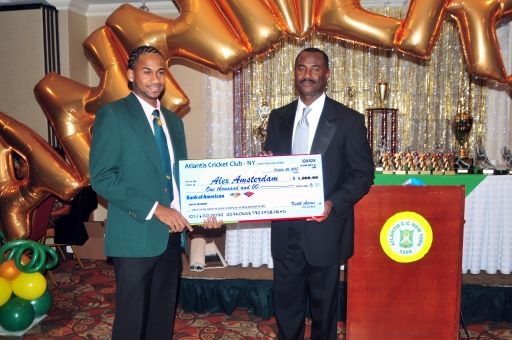 Alex Amsterdam (left) accepts his scholarship check for $1,000. from Atlantis president Steve Welcome