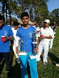 Altaf Habibulla shows off his MVP & Best Bowler Trophies