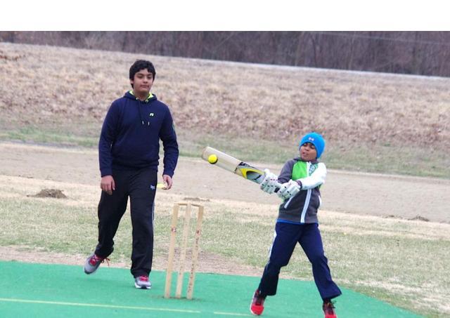 Youth Cricketer on Tip-Toes as he play a short delivery