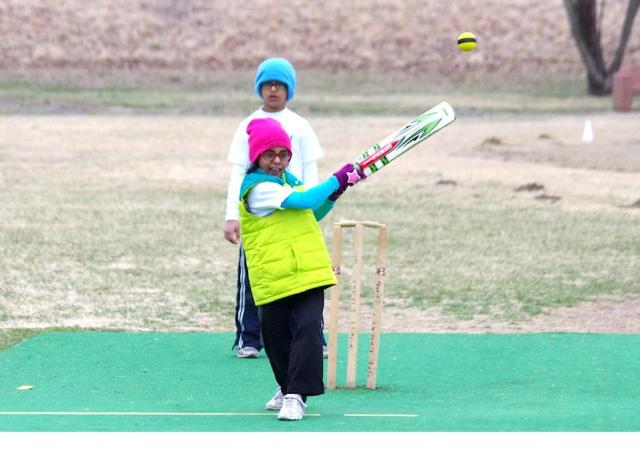 Young Female Cricketer plays a Pull shot