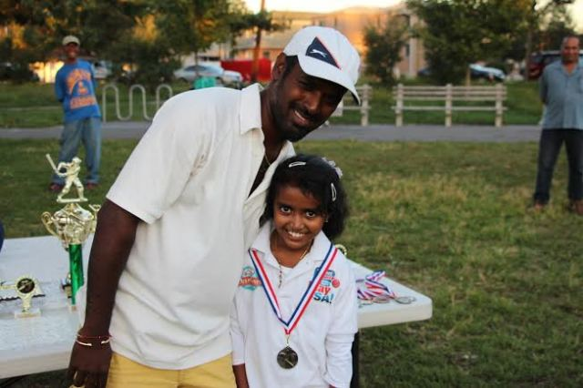 CLPUSA Parent presented a medal to a Female Pee-Wee Cricketer