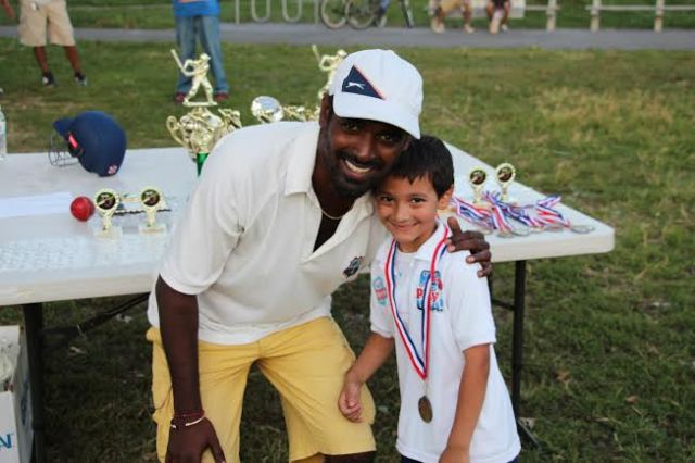 """CLPUSA Parent presented a medal to a """"Pee-Wee Cricketer"""""""
