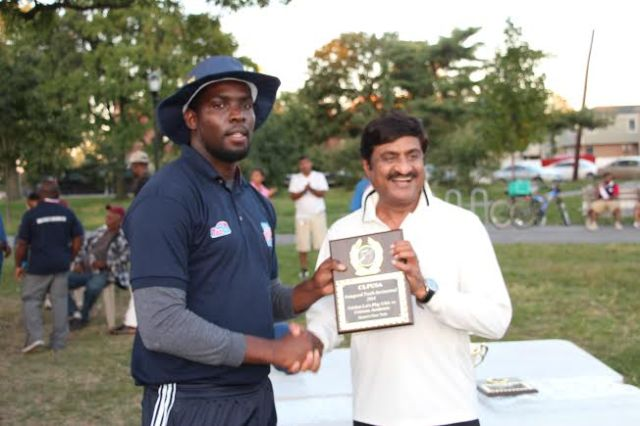 CLPUSA Coach Ravello presented CricMax Coach Ashok Patel with a momento