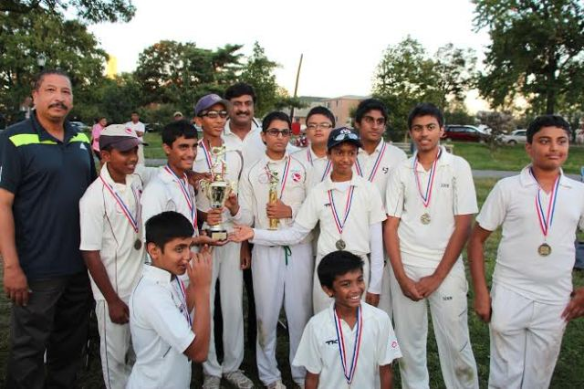 Team Cricmax showing of their medals and trophies presented by the VelloCricket Journal